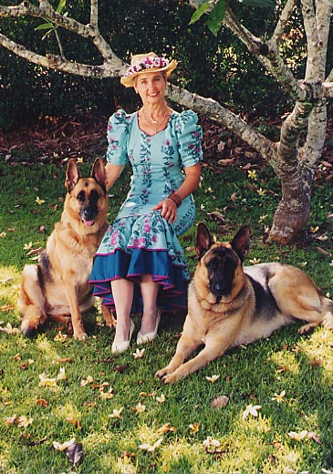 Kathy, with hat, and dogs in back.jpg