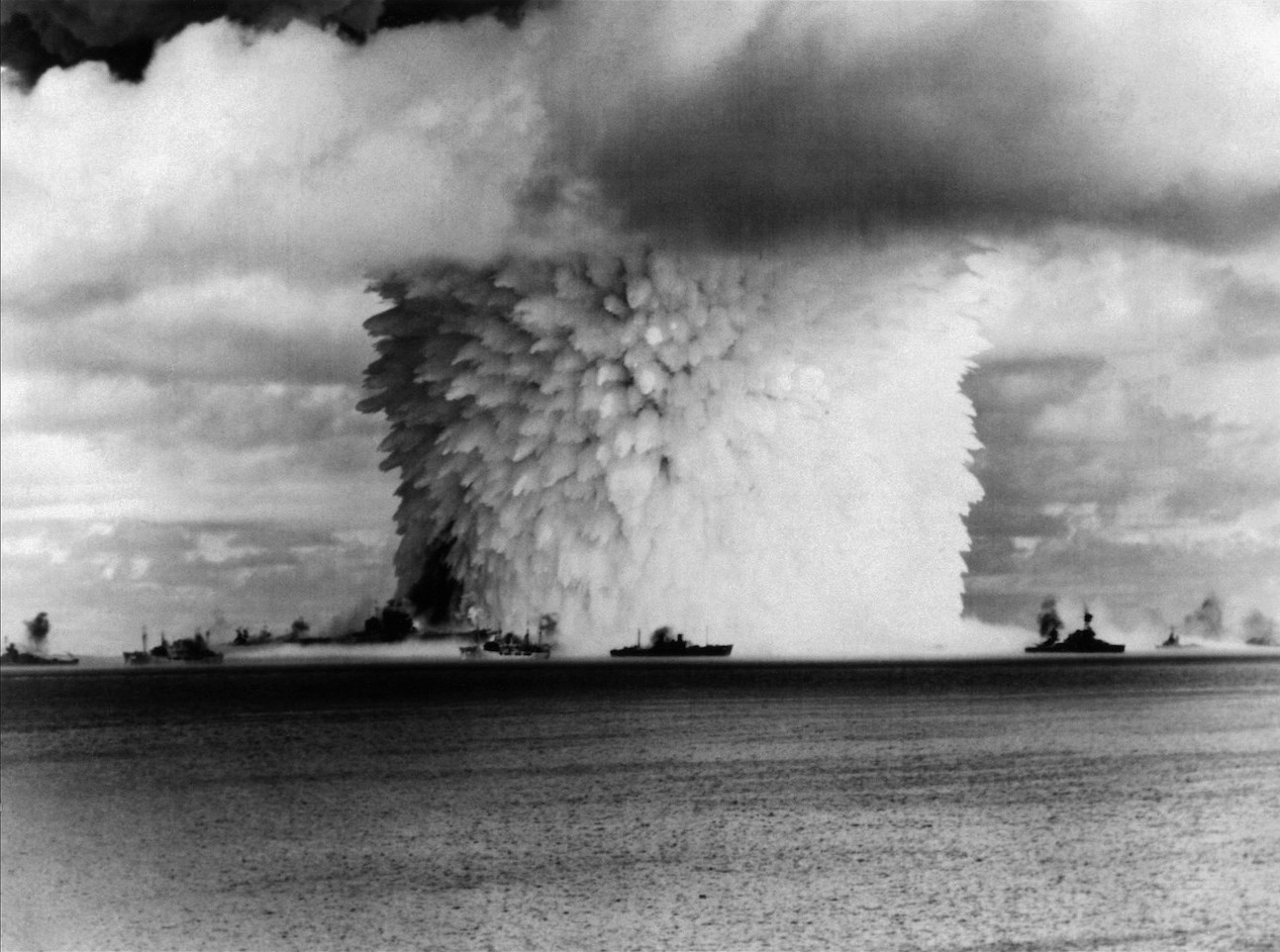 USS_Saratoga_(CV-3)_and_other_ships_are_hit_by_Crossroads_Baker_nuclear_blast,_25_July_1946.jpg
