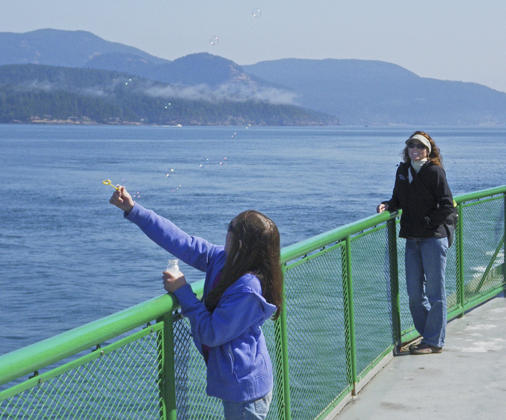 blowing bubbles vancouver ferry.jpg